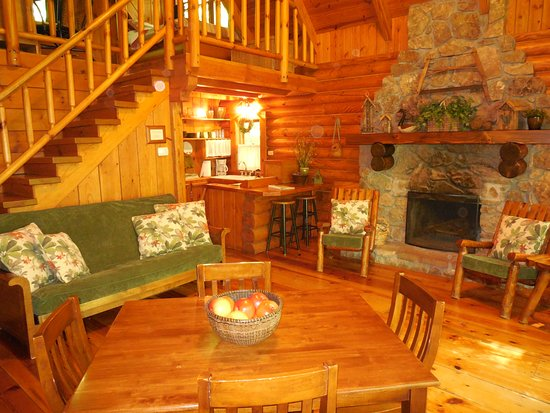 Welcome Valley Village : Ocoee Cabin interior.  Dining/living room with kitchen in the background.