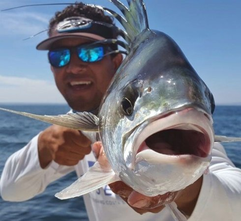 Gulf of Papagayo, Kosta Rika: Oliver handling and posing with a Roosterfish