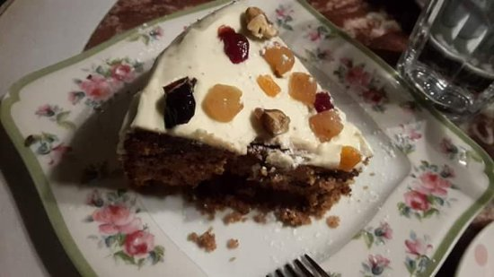 Petite Fleur : A slice of cake with dried fruits and nuts