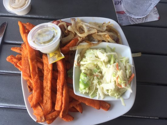 Village Fish Market Restaurant and Lounge: Hot dog with sweet potato fries and Cole slaw
