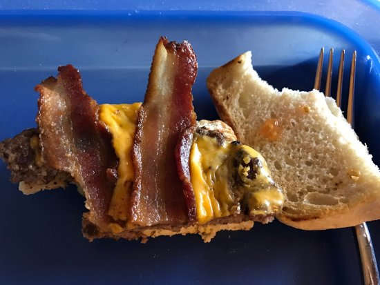 North Liberty, IA: Half burger with one bite - yuck!