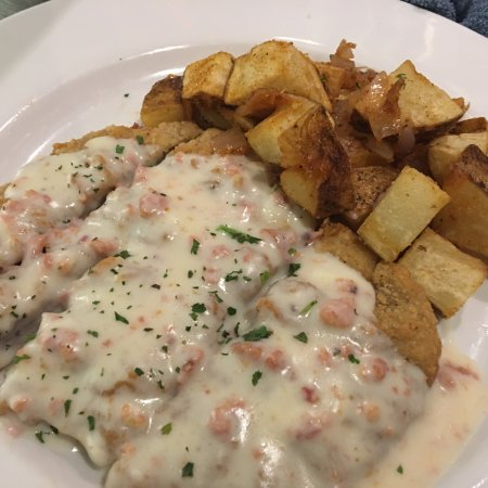 Chicken fried steak with New Orleans country gravy and Redmond's almost famous breakfast potatoe