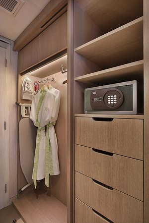 Our Room Cupboard includes: Safety Deposit Box, Iron