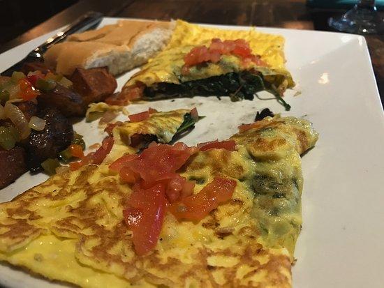 Port Saint Lucie, FL: Omelette served with vegetables.