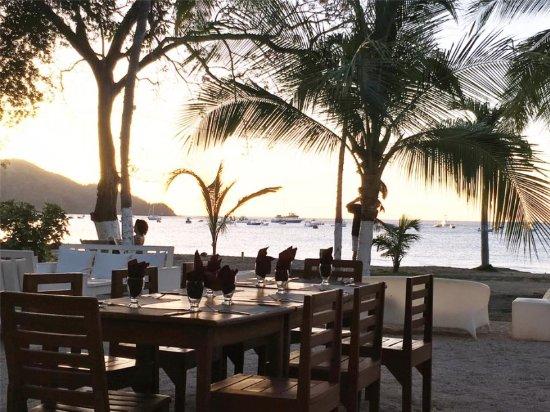Cafe de Playa: El atardecer es precioso desde la silla
