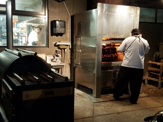 Chelsea's Kitchen: Fellow cooking out front of restaurant