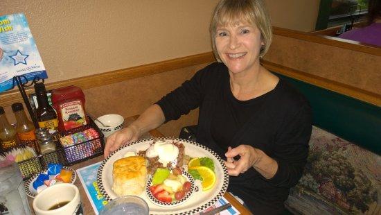 Black Bear Diner: A young lady enjoys eggs Benidict