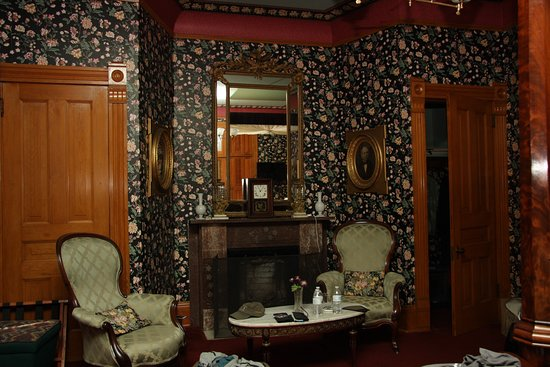 Delavan, WI: Fireplace in our suite flanked by walk-in closets and Louis XV style chairs