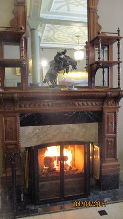 wood in lobby fireplace remington sculpture on mantel picture