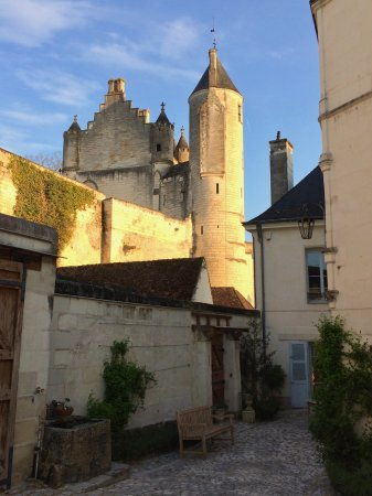 La Maison de l'Argentier du Roy: The view of the city walls and king's residence above the mansion. Mansion courtyard in foregrou