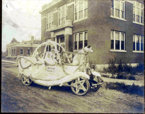 Carnegie Center Gallery: Parade float in front of Carnegie prior to street paving.