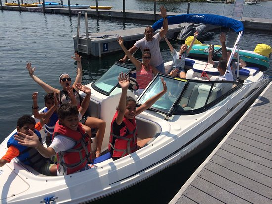 Boyne City, MI: Excited family on our Sea Ray ski boat.