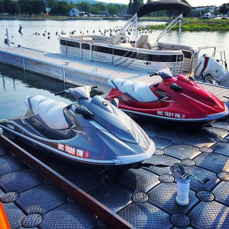 Boyne City, MI: New Yamaha jet skis with our black pontoon in the back round.