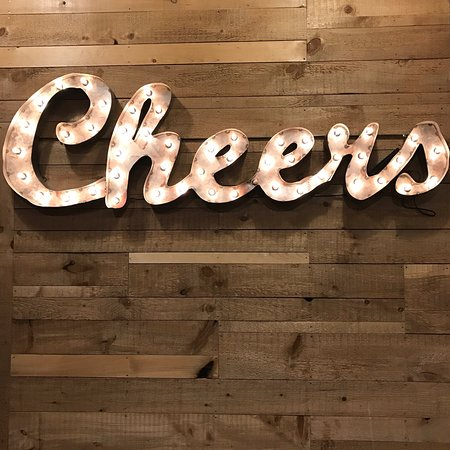 """Shipyard Brewing Company: This """"Cheers"""" sign was hanging on the wall"""