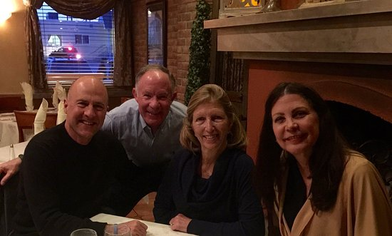 Babylon, NY: Dining with good friends (pic taken in front of the fireplace at Gemelli!