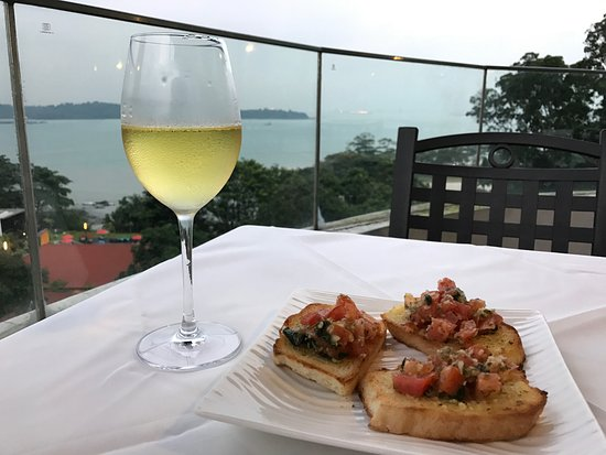 Village Hotel Changi by Far East Hospitality: Bruscheta, wine and view from the 8th floor restaurant terrace