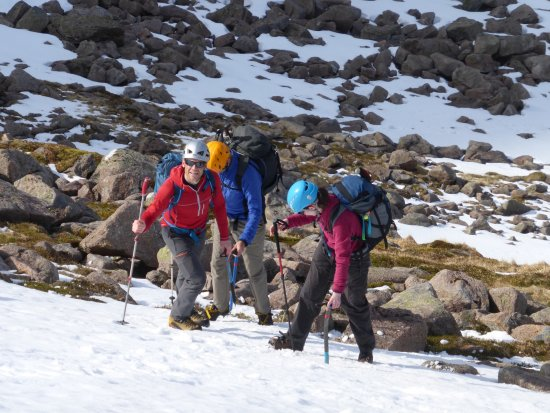 Cairngorm Adventure Guides: Liam (owner/operator of CAG) teaching how to walk up a snow slope