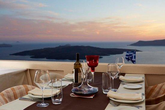 Koukoumavlos Fine Dining Restaurant: View to the famous Santorini volcano from Koukoumavlos's terrace