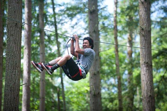 Eatonville, WA: Ziplining on the Adventure course.