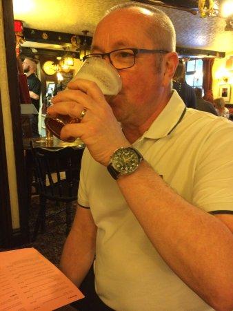 The Unicorn Inn: Hubby enjoying a pint