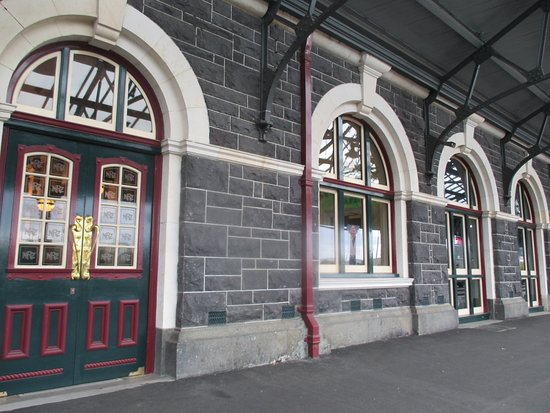 windows and doors on train track side going into dunedin railway