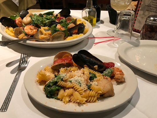 Seafood Rigatoni in spinach garlic butter sauce.