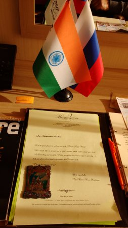 Герцен Хаус Отель: A welcome note, our National flag(Indian) and the RUssian flag on the tableand a souvenier
