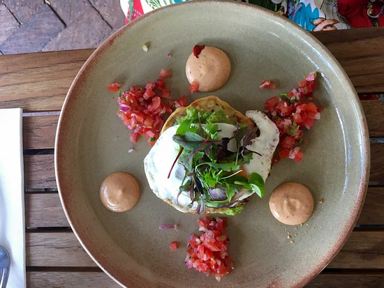 Corner Store Cafe: Corn and zucchini fritters with eggs, salsa and avacado