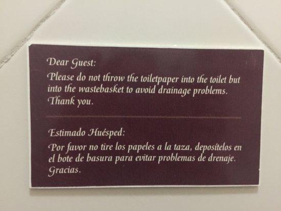 BUCANEROS Hotel & Suites: room, bathroom and sign in bathroom.