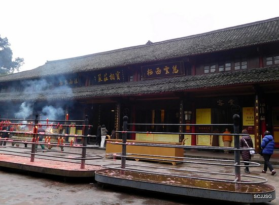 Baoguo Temple: a big tray for people to burn incense
