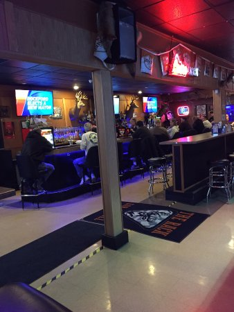 Rochelle, IL: A look into the bar - several TV screens. Juke box and slot machines to the north