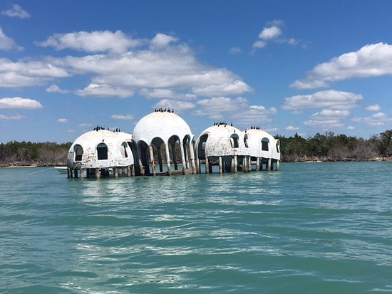 Cape Romano: View of the ruins domes from the shallow water
