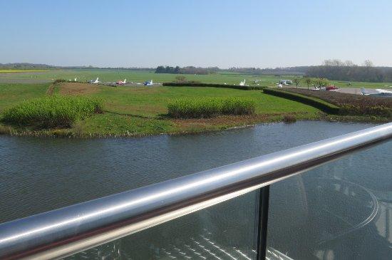 Brackley, UK: Cafe balcony view towards the hangars