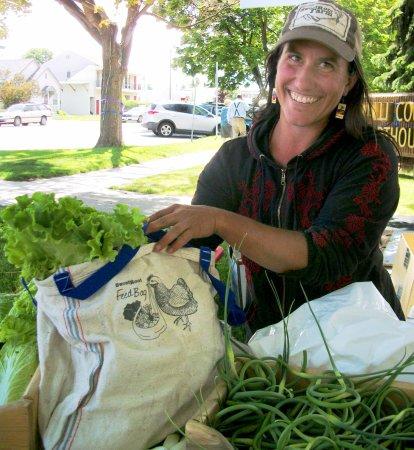 Hamilton, MT: Mary with a Sweetroot Farm produce bag.