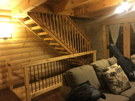 Berlin, OH: stairs leading up to loft and down to lower living / sleeping area
