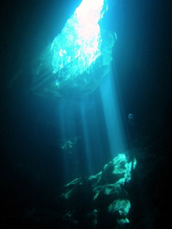 Scuba Tulum: The shafts of light in El Pit appear as if from another world.