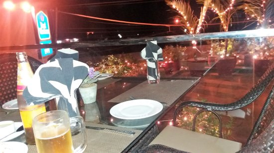Phagwara, India: Terrace Bar, with hustle and bustle of the GT Road in the background not affecting enjoyment.,