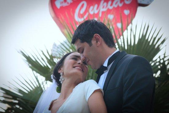 Underneath Cupids Wedding Chapel Heart Sign