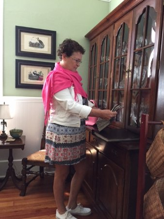 Blue Heron Inn - Amelia Island: The Parlor - me, looking at photos from the renovation
