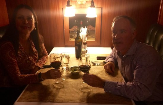 Ted's Montana Grill: Chris and I in our cozy booth enjoying our wine.