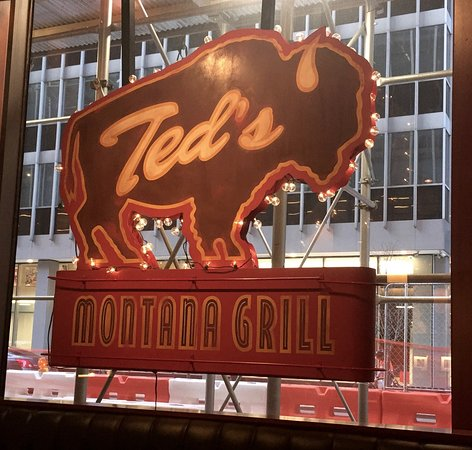 The Ted's Montana Grill sign that greets guests from the window as they arrive.