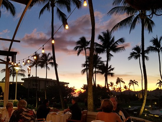 Sunset over Nick's Fishmarket Maui outdoor dining area