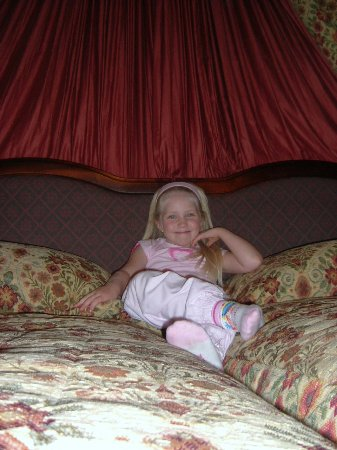 Forres, UK: My daughter relaxing on the great bed in a great room.