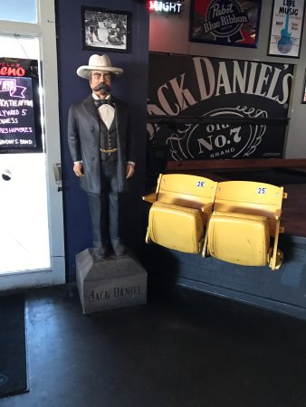 Valley Park, MO: Jack Daniels standing by the stage at Plagers. Notice the seats from the old arena in forefront.