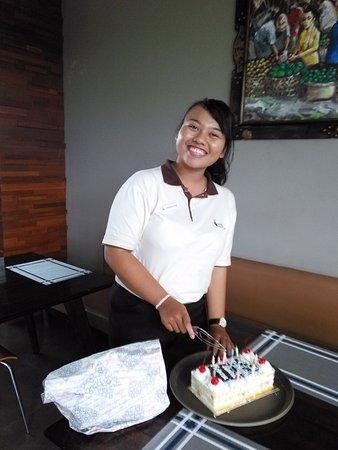 BreadTalk Discovery Shopping Mal: Birthday girl cutting her cake .