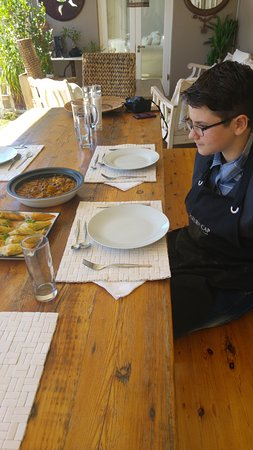 Hout Bay, Afrika Selatan: Michaella sits down to dine upon her culinary delights she has made.