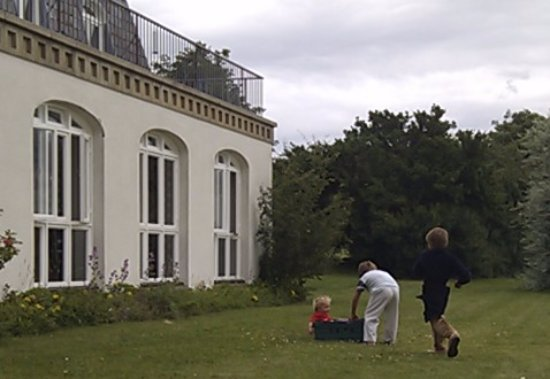Risby, UK: The children playing outside the coach house