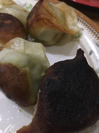 Box Hill, Australia: Undercooked pork fried dumplings & burnt vegetarian dumplings