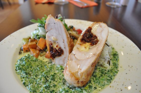 Blonduos, Island: Grilled chicken breast stuffed with sun dried tomatoes and feta cheese, wild rice, spinach sauce