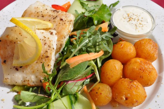 Blonduos, Island: Garlic flavored roasted cod fillet from the seaman with sautéed vegetables, potatoes and tar